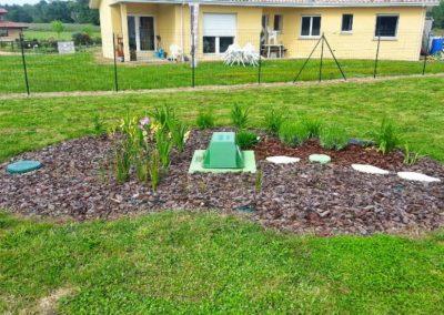 installation d'une fosse septique dans le jardin de la maison